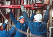 Drilling floor and rough necks. Hibernia offshore oil production platform on the Grand Banks of newfoundland 315km east of St. John's, Newfoundland. Photo by Greg Locke (C) 2006 www.greglocke.com Film scan