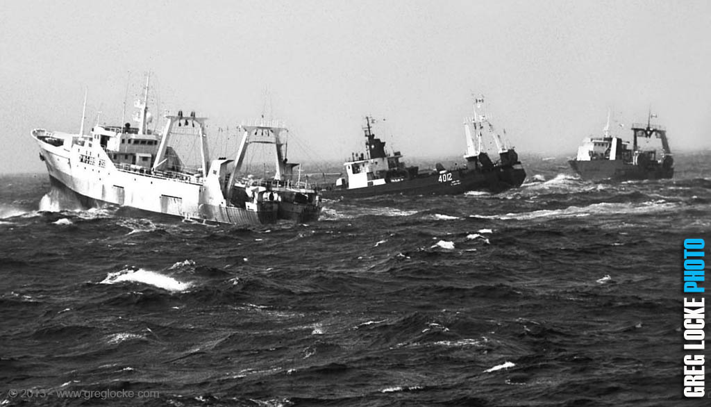 Spanish and Canadian offshore fishing trawlers in the North Atlantic Ocean near the Canadian 200 Mile Limit on the Grand Banks of Newfoundland. © Greg Locke 2000