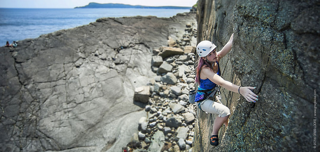 Climbing on Yellow Fever at Flatrock, Newfoundland. Photo by Greg Locke © 2014